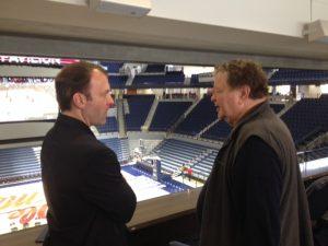 Coach Bjork speaks with attendee